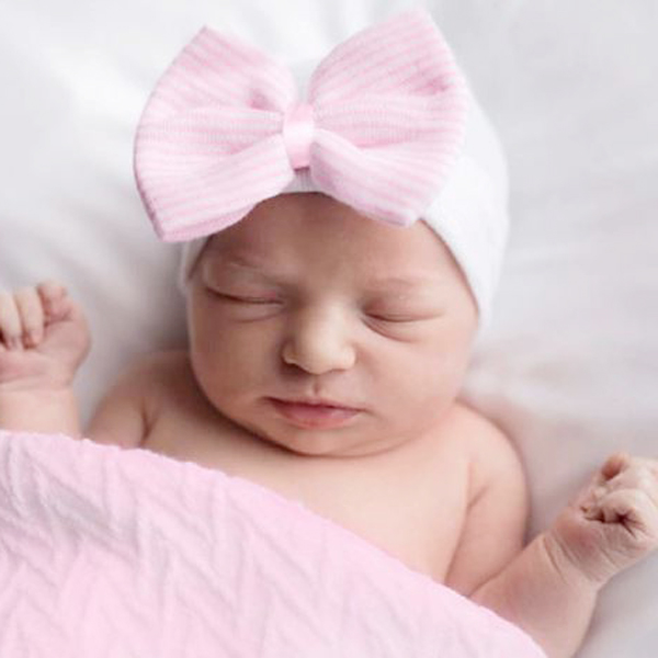 white baby hat pink bow